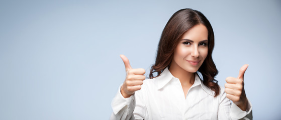 businesswoman, showing thumb up hand sign gesture , over grey