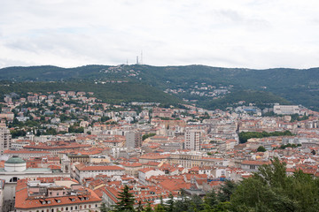 Top view of city with mountains