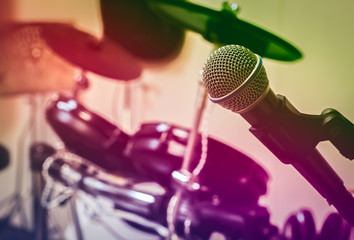 Microphone on blur drum background by vintage tone and vignettin