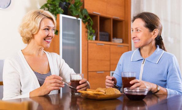 Mature women having tea break