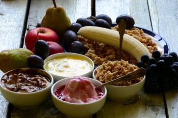Fruit muesli with yogurt and cereals for breakfast