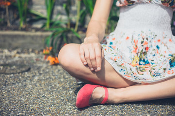 Young woman sitting in meditation pose outside