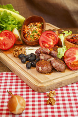 Meat burgers and vegetable.Stew in pot on wooden plank