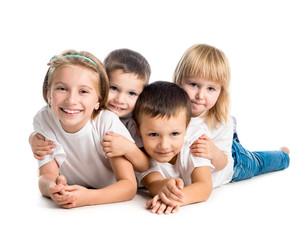smiling children lying on the floor