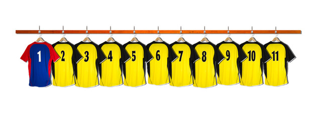 Row of Yellow and blue Football Shirts hanging on wall