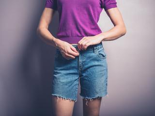 Young woman closing her zip