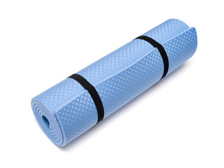 Blue yoga mat for exercise, isolated on white background.