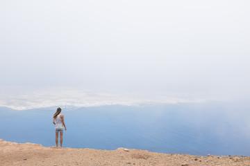 girl in a mountain over the sea