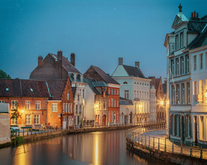 Night Bruges over the waters of Spiegelrei