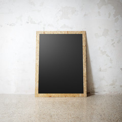 Blank black wooden natural frame on a cocrete wall