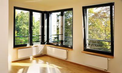 Obraz light room with corner windows - fototapety do salonu