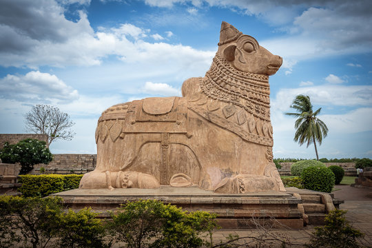 Huge Nandi (bull) statue at ancient Hindu Shiva temple built in 11th century in Tamil Nadu, India