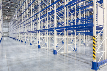 Wall Mural - A new empty distribution warehouse with high shelves