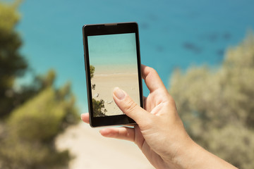 Taking a snapshot of a beautiful beach with a cellphone