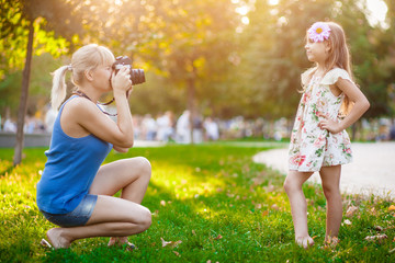Woman photographing child