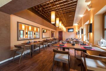 Restaurant room with wooden furniture