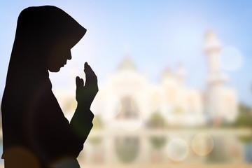 Muslim Woman pray and Beautiful background..
