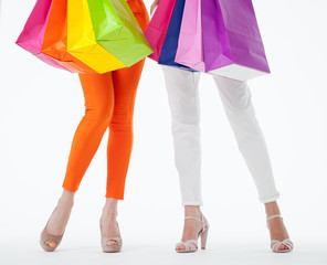 Two women holding  multicolored shopping bags