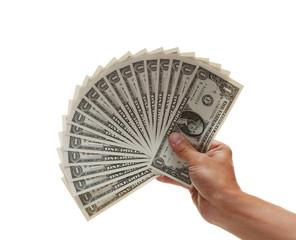 Hand holding fan of dollar bills