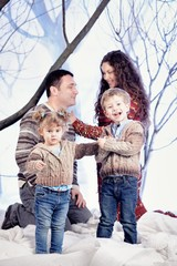 Family portrait in studio snow forest background