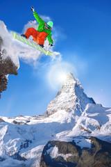 Wall Mural - Snowboarder jumping against Matterhorn peak in Switzerland