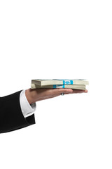 Hand of a business man holding money
