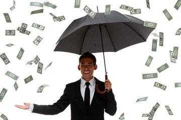 Half-body of a business man holding an umbrella in raining money