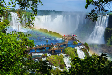 Tourists at Iguazu Falls, on the border of Brazil, Argentina, and Paraguay.