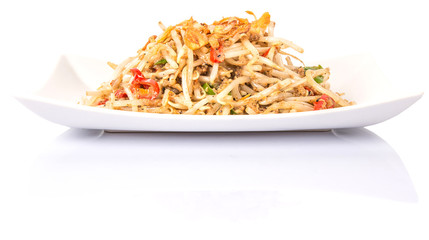 Malaysian dish bean sprout salad or local name Kerabu Taugeh in a white plate over white background