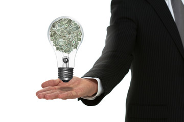 Businessman holding out arm with a money lightbulb floating abov