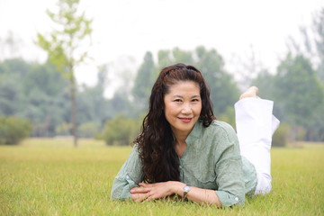 Smiling older woman on the lawn