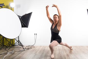Young ballet dancer in studio