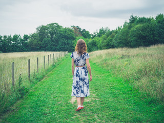 Young woman walking in the countryside