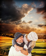 Composite image of happy cute couple romancing