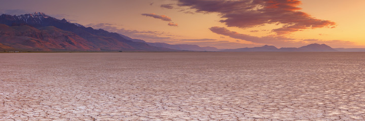 Cracked earth in remote Alvord Desert, Oregon, USA at sunrise