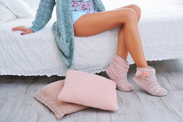Beautiful woman legs in knitted boot slippers