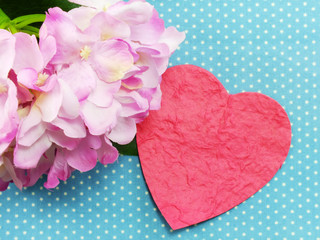 valentine day concept heart on wooden background with beautiful pink flower