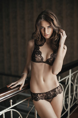 Beautiful brunette model in expensive lace lingerie.