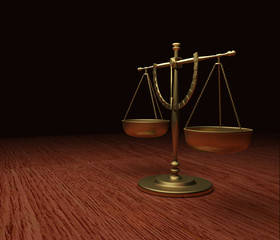 Gold Scales of Justice on wood table