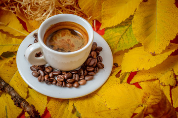 Coffee Espresso. Cup Of Coffee With  Yellow Autumn Leaves