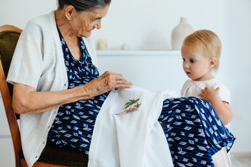89 -year-old grandmother sew and teach granddaughter