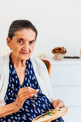Portrait of a smiling old woman while ties