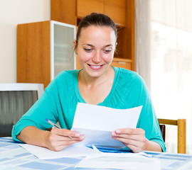 girl filling out tax forms