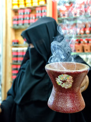 A woman selling frankincense at the Souq Al Hasn, Salalah, Dhofar Governorate, Sultanate of Oman
