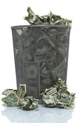 Garbage can full of money spilling over