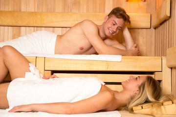 Man and a woman enjoying wellness day in sauna