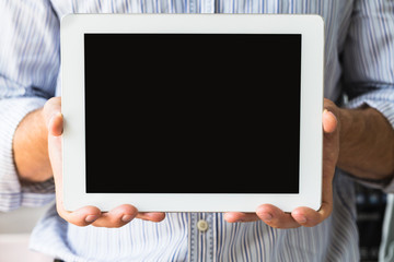 Tablet in male hands