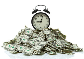 Clock on top of a pile of cash