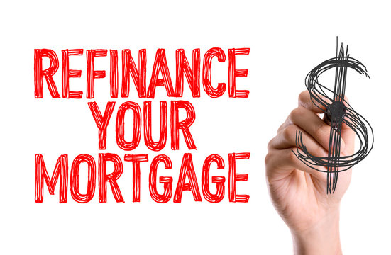 Hand with marker writing: Refinance Your Mortgage