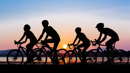 People cycling at beach